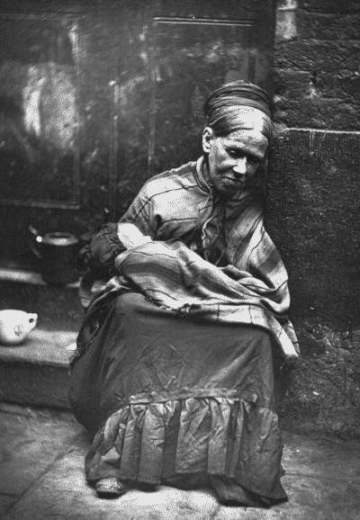 Poor woman & child