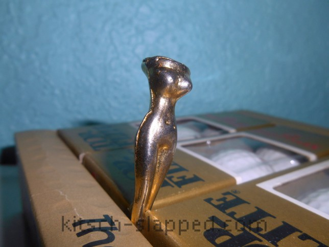vintage gold plated golf tee in the shape of a women's nude body